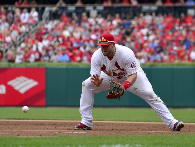 Sep 25, 2013; St. Louis, MO, USA; St. Louis Cardinals first baseman Matt Adams (53) makes a play against the Washington Nationals at Busch Stadium. The Cardinals defeated the Nationals 4-1. Mandatory Credit: Scott Rovak-USA TODAY Sports