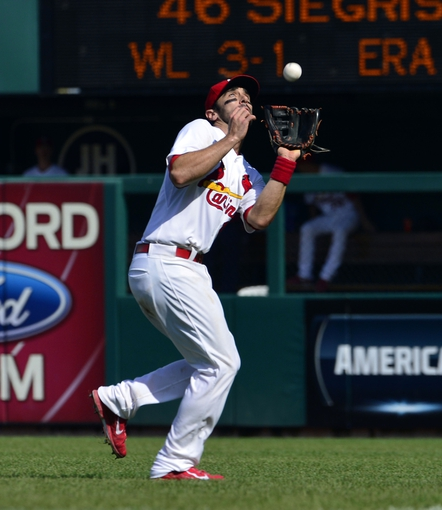 Sep 25, 2013; St. Louis, MO, USA; St. Louis Cardinals second baseman Matt Carpenter (13) makes a catch against the Washington Nationals at Busch Stadium. The Cardinals defeated the Nationals 4-1. Mandatory Credit: Scott Rovak-USA TODAY Sports