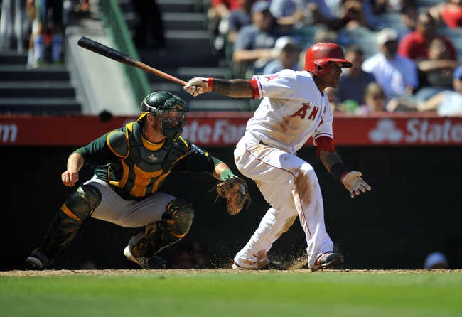 September 25, 2013; Anaheim, CA, USA; Los Angeles Angels shortstop Erick Aybar (2) hits an RBI single in the fifth inning against the Oakland Athletics at Angel Stadium of Anaheim. Mandatory Credit: Gary A. Vasquez-USA TODAY Sports