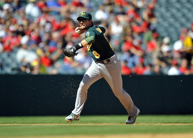September 25, 2013; Anaheim, CA, USA; Oakland Athletics shortstop Jed Lowrie (8) throws to first to complete an out in the fifth inning against the Los Angeles Angels at Angel Stadium of Anaheim. Mandatory Credit: Gary A. Vasquez-USA TODAY Sports
