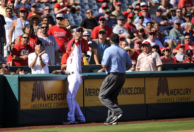 September 25, 2013; Anaheim, CA, USA; Los Angeles Angels shortstop Andrew Romine (7) catches a fly ball in foul territory in the seventh inning against the Oakland Athletics at Angel Stadium of Anaheim. Mandatory Credit: Gary A. Vasquez-USA TODAY Sports