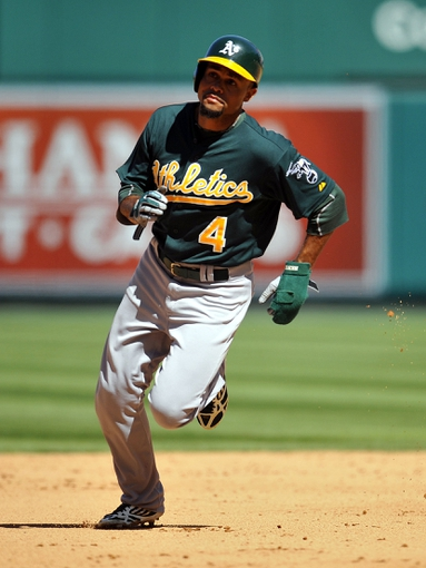 September 25, 2013; Anaheim, CA, USA; Oakland Athleticscenter fielder Coco Crisp (4) runs to third in the sixth inning against the Los Angeles Angels at Angel Stadium of Anaheim. Mandatory Credit: Gary A. Vasquez-USA TODAY Sports
