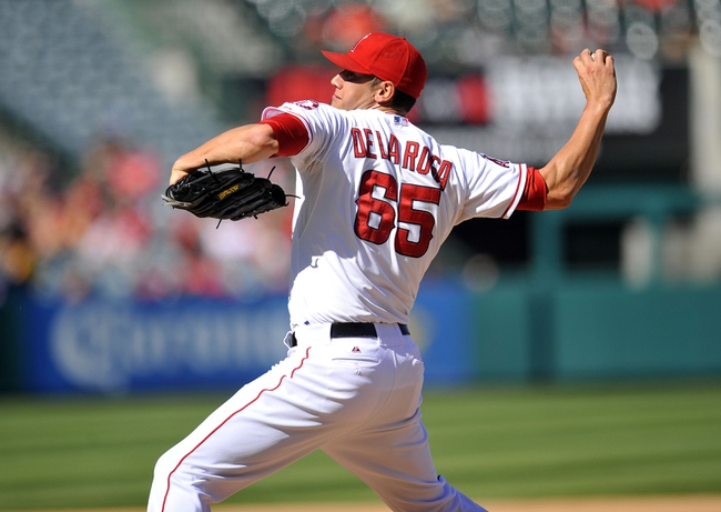 September 25, 2013; Anaheim, CA, USA; Los Angeles Angels relief pitcher Dane De La Rosa (65) pitches during the eighth inning against the Oakland Athletics at Angel Stadium of Anaheim. Mandatory Credit: Gary A. Vasquez-USA TODAY Sports