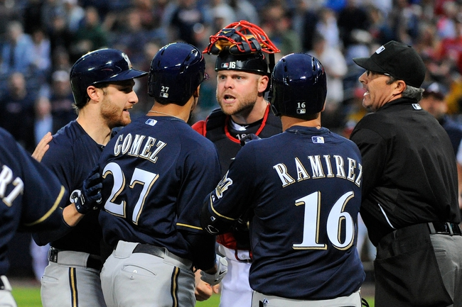 Sep 25, 2013; Atlanta, GA, USA; Milwaukee Brewers center fielder Carlos Gomez (27) reacts with Atlanta Braves catcher Brian McCann (16) after hitting a home run during the first inning at Turner Field. Mandatory Credit: Dale Zanine-USA TODAY Sports