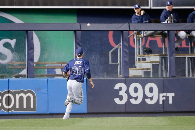 Sep 25, 2013; Bronx, NY, USA;  Tampa Bay Rays right fielder Matt Joyce (20) chases a ball during the first inning against the New York Yankees at Yankee Stadium. Mandatory Credit: Anthony Gruppuso-USA TODAY Sports
