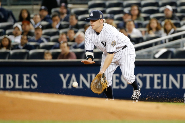 Sep 25, 2013; Bronx, NY, USA;  New York Yankees first baseman Mark Reynolds (39) attempts to recover the ball on a throwing error by the shortstop during the first inning against the Tampa Bay Rays at Yankee Stadium. Mandatory Credit: Anthony Gruppuso-USA TODAY Sports