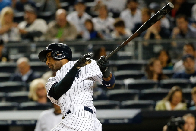 Sep 25, 2013; Bronx, NY, USA;  New York Yankees shortstop Eduardo Nunez (26) doubles during the first inning against the Tampa Bay Rays at Yankee Stadium. Mandatory Credit: Anthony Gruppuso-USA TODAY Sports