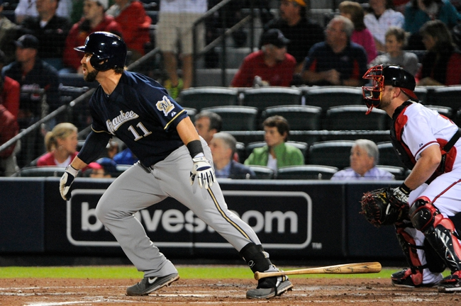Sep 25, 2013; Atlanta, GA, USA; Milwaukee Brewers first baseman Sean Halton (11) hits a sacrifice fly to score a run against the Atlanta Braves during the fourth inning at Turner Field. Mandatory Credit: Dale Zanine-USA TODAY Sports