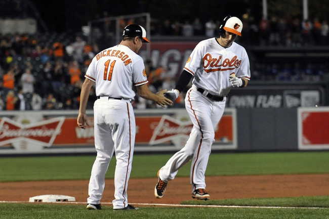 Sep 25, 2013; Baltimore, MD, USA; Baltimore Orioles third baseman Ryan Flaherty (3) is congratulated by third base coach Bobby Dickerson (11) after hitting a two-run home run in the third inning against the Toronto Blue Jays at Oriole Park at Camden Yards. Mandatory Credit: Joy R. Absalon-USA TODAY Sports