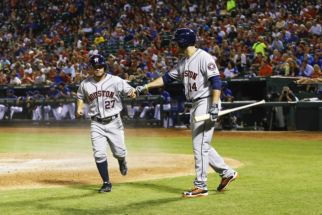 Sep 25, 2013; Arlington, TX, USA; Houston Astros second baseman Jose Altuve (27) celebrates with left fielder J.D. Martinez (14) after scoring during the game against the Texas Rangers at Rangers Ballpark in Arlington. Mandatory Credit: Kevin Jairaj-USA TODAY Sports