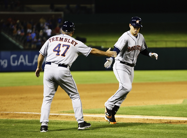 Sep 25, 2013; Arlington, TX, USA; Houston Astros designated hitter Brandon Laird (4) celebrates with third base coach Dave Trembley (47) after hitting a home run during the fourth inning  against the Texas Rangers at Rangers Ballpark in Arlington. Mandatory Credit: Kevin Jairaj-USA TODAY Sports