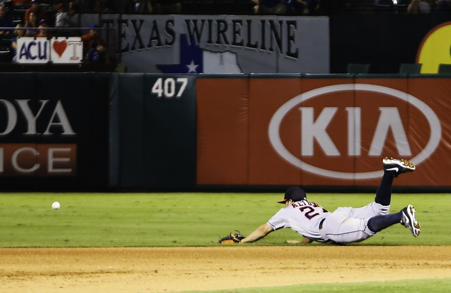 Sep 25, 2013; Arlington, TX, USA; Houston Astros second baseman Jose Altuve (27) dives for but cannot field a ball during the game against the Texas Rangers at Rangers Ballpark in Arlington. Mandatory Credit: Kevin Jairaj-USA TODAY Sports