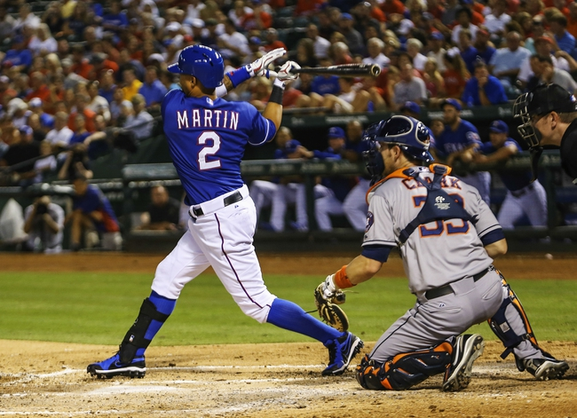Sep 25, 2013; Arlington, TX, USA; Texas Rangers center fielder Leonys Martin (2) hits a three run double during the fourth inning against the Houston Astros at Rangers Ballpark in Arlington. Mandatory Credit: Kevin Jairaj-USA TODAY Sports