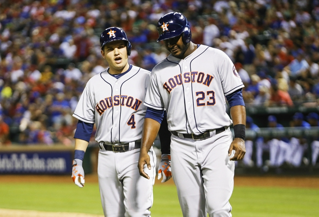 Sep 25, 2013; Arlington, TX, USA; Houston Astros designated hitter Brandon Laird (4) celebrates with first baseman Chris Carter (23) after hitting a home run during the fourth inning  against the Texas Rangers at Rangers Ballpark in Arlington. Mandatory Credit: Kevin Jairaj-USA TODAY Sports