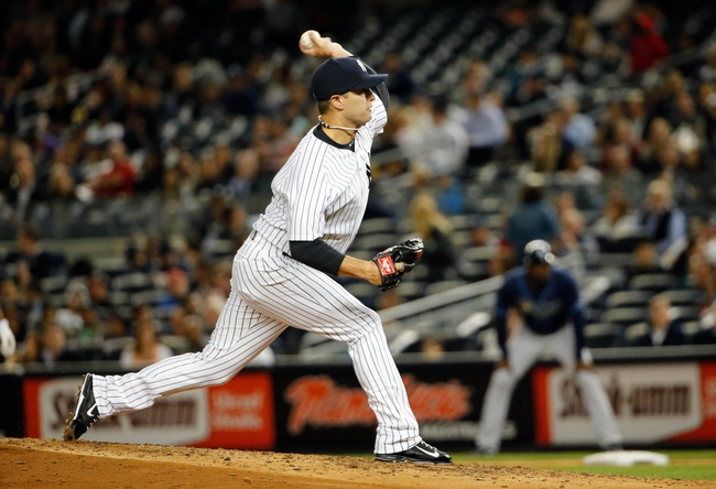 Sep 25, 2013; Bronx, NY, USA;  New York Yankees relief pitcher David Huff (60) delivers a pitch during the third inning against the Tampa Bay Rays at Yankee Stadium. Mandatory Credit: Anthony Gruppuso-USA TODAY Sports