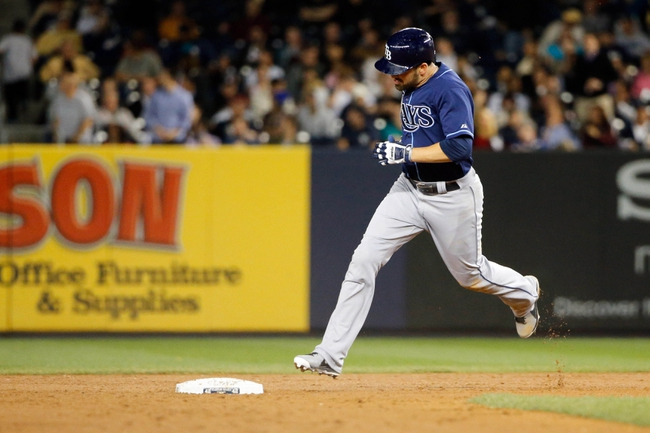 Sep 25, 2013; Bronx, NY, USA;   Tampa Bay Rays left fielder David DeJesus (7) rounds the bases on his home run during the sixth inning against the New York Yankees at Yankee Stadium. Mandatory Credit: Anthony Gruppuso-USA TODAY Sports