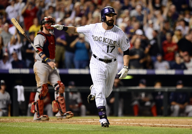 Sep 25, 2013; Denver, CO, USA; Colorado Rockies first baseman Todd Helton (17) runs the bases after a home run in the second inning of the game against the Boston Red Sox at Coors Field. Mandatory Credit: Ron Chenoy-USA TODAY Sports