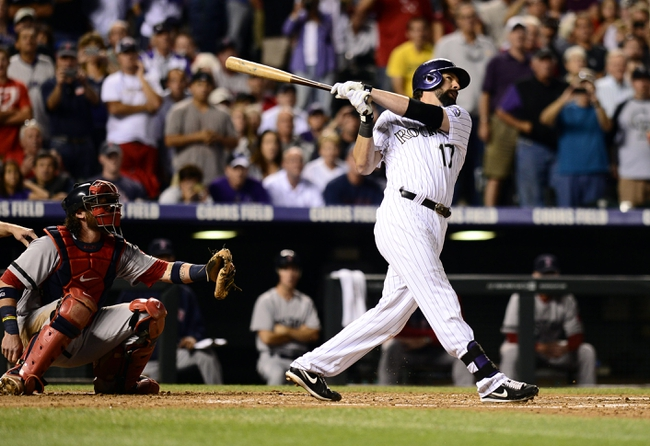 Sep 25, 2013; Denver, CO, USA; Colorado Rockies first baseman Todd Helton (17) hits a home run in the second inning of the game against the Boston Red Sox at Coors Field. Mandatory Credit: Ron Chenoy-USA TODAY Sports
