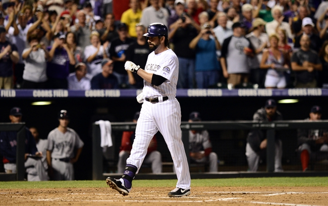 Sep 25, 2013; Denver, CO, USA; Colorado Rockies first baseman Todd Helton (17) steps on home plate after a home run in the second inning of the game against the Boston Red Sox at Coors Field. Mandatory Credit: Ron Chenoy-USA TODAY Sports