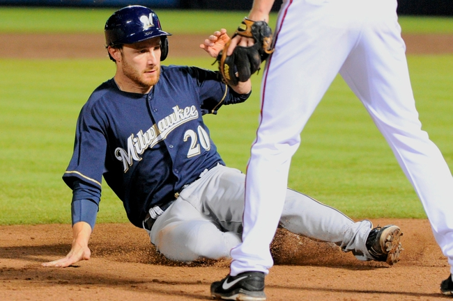 Sep 25, 2013; Atlanta, GA, USA; Milwaukee Brewers catcher Jonathan Lucroy (20) slides into third base against the Atlanta Braves during the eighth inning at Turner Field. The Brewers defeated the Braves 4-0. Mandatory Credit: Dale Zanine-USA TODAY Sports