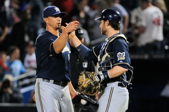 Sep 25, 2013; Atlanta, GA, USA; Milwaukee Brewers starting pitcher Kyle Lohse (26) and catcher Jonathan Lucroy (20) react after defeating the Atlanta Braves at Turner Field. The Brewers defeated the Braves 4-0. Mandatory Credit: Dale Zanine-USA TODAY