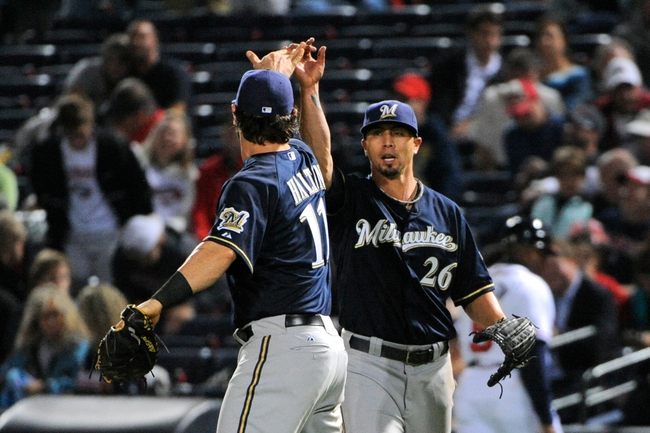 Sep 25, 2013; Atlanta, GA, USA; Milwaukee Brewers first baseman Sean Halton (11) and starting pitcher Kyle Lohse (26) react after defeating the Atlanta Braves at Turner Field. The Brewers defeated the Braves 4-0. Mandatory Credit: Dale Zanine-USA TODAY Sports