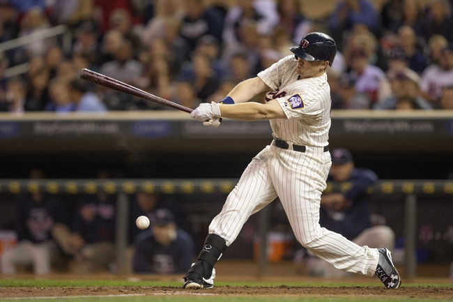 Sep 25, 2013; Minneapolis, MN, USA; Minnesota Twins first baseman Chris Parmelee (27) hits a infield single in the fourth inning against the Detroit Tigers at Target Field. Mandatory Credit: Jesse Johnson-USA TODAY Sports