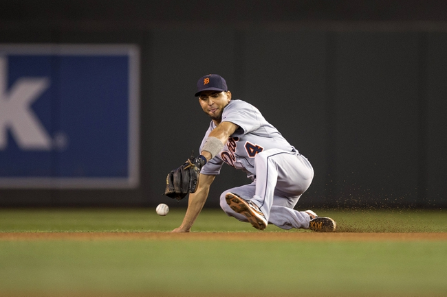Sep 25, 2013; Minneapolis, MN, USA; Detroit Tigers second baseman Omar Infante (4) attempts to field a ground ball in the fifth inning against the Minnesota Twins at Target Field. Mandatory Credit: Jesse Johnson-USA TODAY Sports