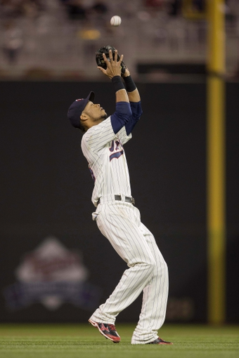 Sep 25, 2013; Minneapolis, MN, USA; Minnesota Twins shortstop Pedro Florimon (25) catches a fly ball in the fifth inning against the Detroit Tigers at Target Field. Mandatory Credit: Jesse Johnson-USA TODAY Sports