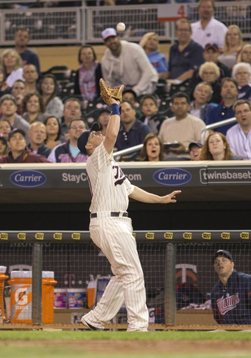 Sep 25, 2013; Minneapolis, MN, USA; Minnesota Twins first baseman Chris Parmelee (27) catches a pop fly in the sixth inning against the Detroit Tigers at Target Field. Mandatory Credit: Jesse Johnson-USA TODAY Sports