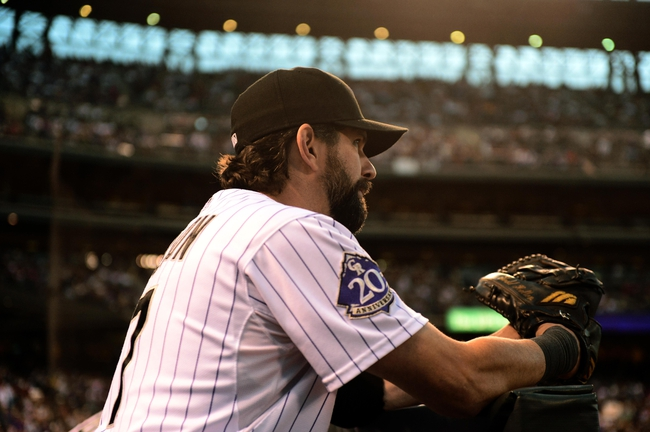 ep 25, 2013; Denver, CO, USA; Colorado Rockies first baseman Todd Helton (17) prepares to take to the field before the start of the game against the Boston Red Sox at Coors Field. Mandatory Credit: Ron Chenoy-USA TODAY Sports