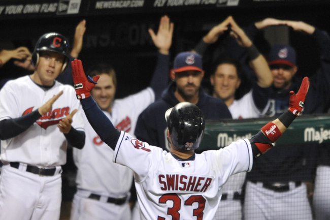 Sep 25, 2013; Cleveland, OH, USA; Cleveland Indians first baseman Nick Swisher celebrates his two-run home run in the fifth inning against the Chicago White Sox at Progressive Field. Mandatory Credit: David Richard-USA TODAY Sports