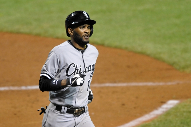 Sep 25, 2013; Cleveland, OH, USA; Chicago White Sox shortstop Alexei Ramirez reacts after scoring in the sixth inning against the Cleveland Indians at Progressive Field. Mandatory Credit: David Richard-USA TODAY Sports