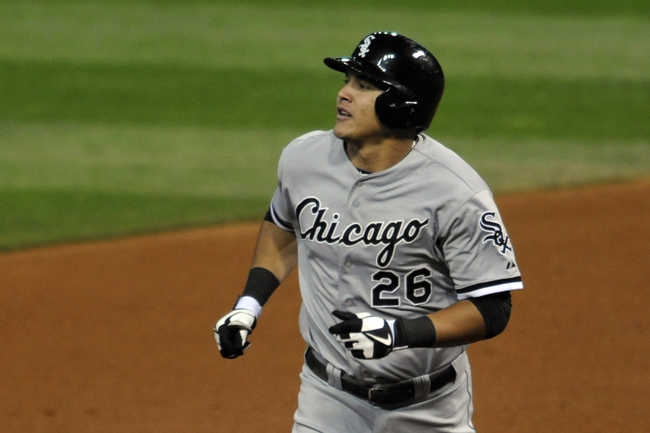 Sep 25, 2013; Cleveland, OH, USA; Chicago White Sox right fielder Avisail Garcia (26) rounds the bases on his solo home run in the second inning against the Cleveland Indians at Progressive Field. Mandatory Credit: David Richard-USA TODAY Sports