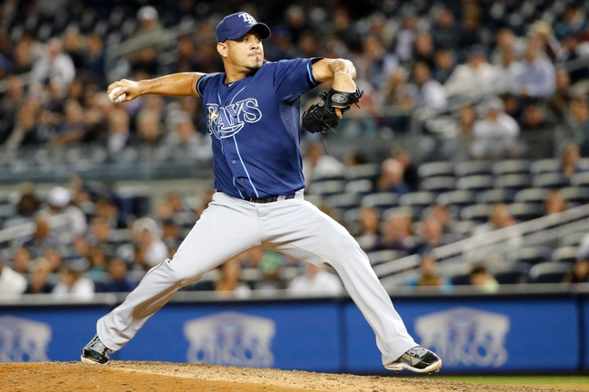 Sep 25, 2013; Bronx, NY, USA;  Tampa Bay Rays relief pitcher Joel Peralta (62) pitches during the eighth inning against the New York Yankees at Yankee Stadium. Rays won 8-3.  Mandatory Credit: Anthony Gruppuso-USA TODAY Sports