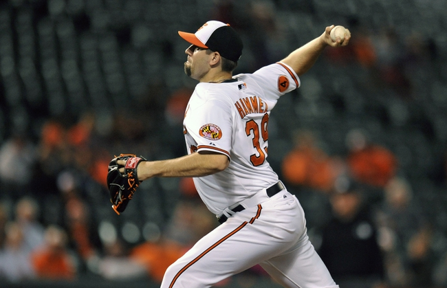 Sep 25, 2013; Baltimore, MD, USA; Baltimore Orioles starting pitcher Jason Hammel (39) throws in the ninth inning against the Toronto Blue Jays at Oriole Park at Camden Yards. The Orioles defeated the Blue Jays 9-5. Mandatory Credit: Joy R. Absalon-USA TODAY Sports