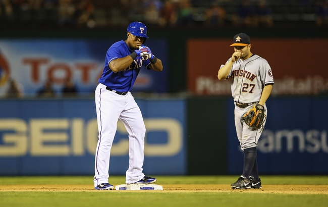 Sep 25, 2013; Arlington, TX, USA; Texas Rangers third baseman Adrian Beltre (29) reacts after hitting a double as Houston Astros second baseman Jose Altuve (27) looks on during the game at Rangers Ballpark in Arlington. Mandatory Credit: Kevin Jairaj-USA TODAY Sports
