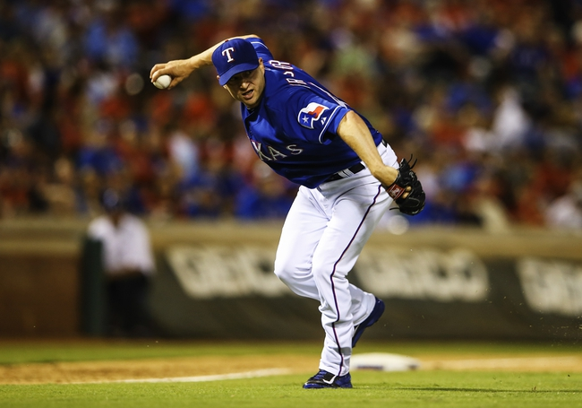 Sep 25, 2013; Arlington, TX, USA; Texas Rangers relief pitcher Jason Frasor (44) cannot make the out at first base during the game against the Houston Astros at Rangers Ballpark in Arlington. Mandatory Credit: Kevin Jairaj-USA TODAY Sports