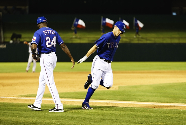 Sep 25, 2013; Arlington, TX, USA; Texas Rangers second baseman Ian Kinsler (5) celebrates his home run with third base coach Gary Pettis (24) during the sixth inning against the Houston Astros at Rangers Ballpark in Arlington. Mandatory Credit: Kevin Jairaj-USA TODAY Sports