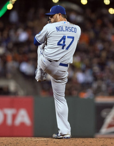 Sep 25, 2013; San Francisco, CA, USA; Los Angeles Dodgers starting pitcher Ricky Nolasco (47) pitches against the San Francisco Giants during the third inning at AT&T Park. Mandatory Credit: Ed Szczepanski-USA TODAY Sports