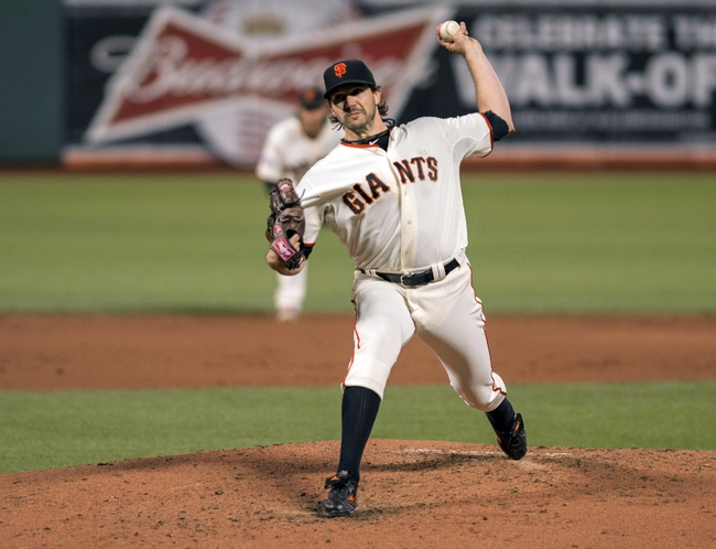 Sep 25, 2013; San Francisco, CA, USA; San Francisco Giants starting pitcher Barry Zito (75) pitches against the Los Angeles Dodgers during the third inning at AT&T Park. Mandatory Credit: Ed Szczepanski-USA TODAY Sports