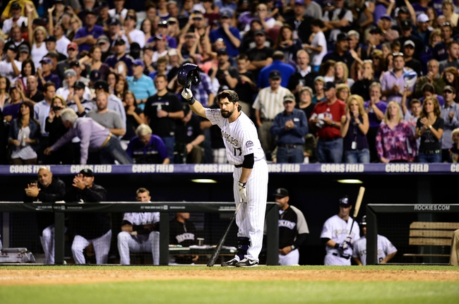 Sep 25, 2013; Denver, CO, USA; Colorado Rockies first baseman Todd Helton (17) tips his helmet before going up to bat in the fifth inning of the game against the Boston Red Sox at Coors Field. Mandatory Credit: Ron Chenoy-USA TODAY Sports