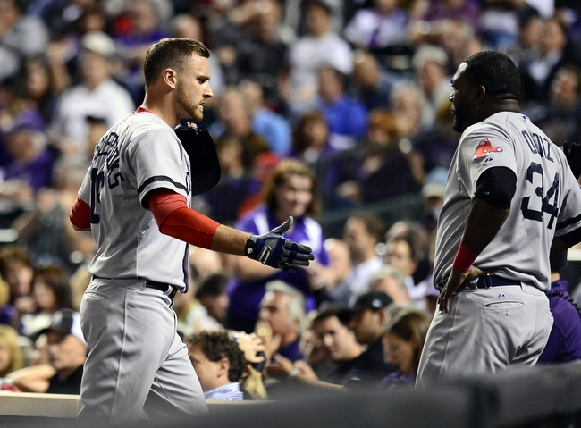 Sep 25, 2013; Denver, CO, USA; Boston Red Sox third baseman Will Middlebrooks (16) reacts with first baseman David Ortiz (34) near the dugout after hitting a home run in the fifth against the Colorado Rockies at Coors Field. Mandatory Credit: Ron Chenoy-USA TODAY Sports