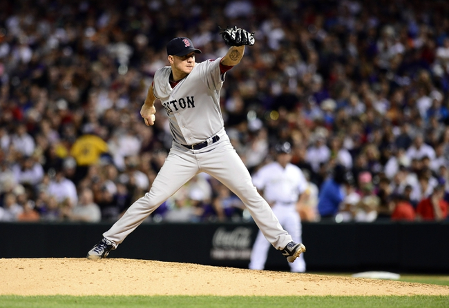 Sep 25, 2013; Denver, CO, USA; Boston Red Sox starting pitcher Jake Peavy (44) prepares to deliver a pitch in the fifth inning of the game against the Boston Red Sox at Coors Field. Mandatory Credit: Ron Chenoy-USA TODAY Sports