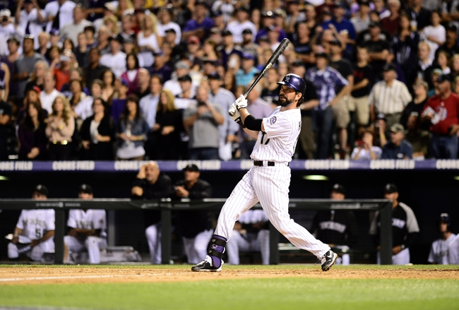 Sep 25, 2013; Denver, CO, USA; Colorado Rockies first baseman Todd Helton (17) hits a double in the fifth inning of the game against the Boston Red Sox at Coors Field. Mandatory Credit: Ron Chenoy-USA TODAY Sports