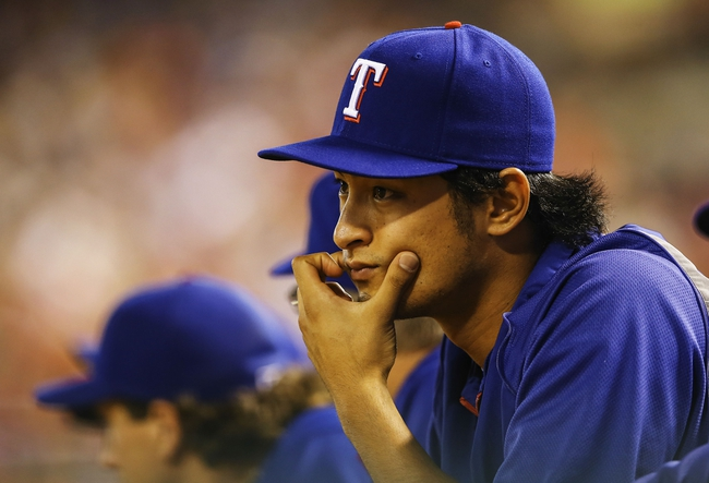 Sep 25, 2013; Arlington, TX, USA; Texas Rangers starting pitcher Yu Darvish (11) reacts during the game against the Houston Astros at Rangers Ballpark in Arlington. Mandatory Credit: Kevin Jairaj-USA TODAY Sports