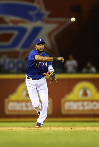 Sep 25, 2013; Arlington, TX, USA; Texas Rangers shortstop Elvis Andrus (1) throws to first base during the game against the Houston Astros at Rangers Ballpark in Arlington. Mandatory Credit: Kevin Jairaj-USA TODAY Sports