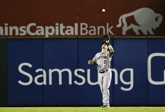 Sep 25, 2013; Arlington, TX, USA; Houston Astros center fielder Brandon Barnes (2) catches a fly ball during the game against the Texas Rangers at Rangers Ballpark in Arlington. Mandatory Credit: Kevin Jairaj-USA TODAY Sports