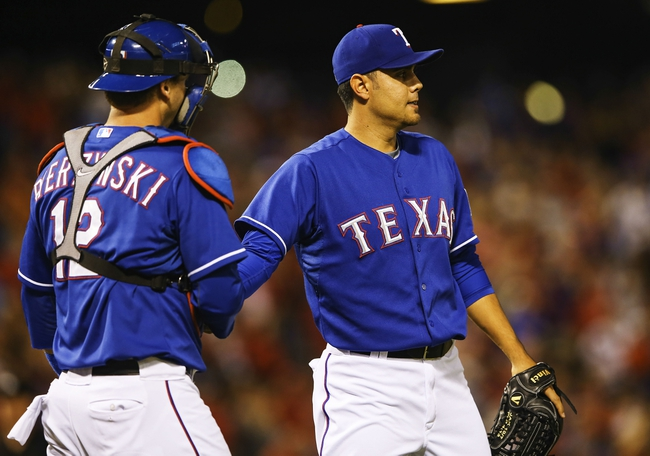 Sep 25, 2013; Arlington, TX, USA; Texas Rangers relief pitcher Joakim Soria (28) and catcher A.J. Pierzynski (12) celebrate the victory against the Houston Astros at Rangers Ballpark in Arlington. Mandatory Credit: Kevin Jairaj-USA TODAY Sports