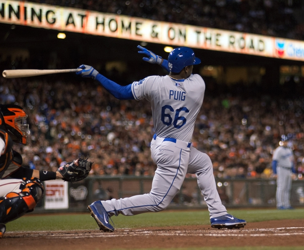 Sep 25, 2013; San Francisco, CA, USA; Los Angeles Dodgers right fielder Yasiel Puig (66) hits a single against the San Francisco Giants during the fourth inning at AT&T Park. Mandatory Credit: Ed Szczepanski-USA TODAY Sports